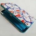 กระเป๋า 3in1 ใส่ มือถือ ใส่เงิน ใส่นามบัตร ในใบเดียวคะ มือถือไม่เกิน 5.5 นิ้ว ใส่ได้ค่ะ ลาย โดราเอม่