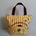 กระเป๋าถือ (ผ้า) ลาย ปอมปอมบุริน Pompompurin ขนาด 11x8.5 นิ้ว ปากกระเป๋ามีซิป ค่ะ