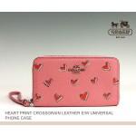 กระเป๋าคล้องมือ COACH PINK HEART CROSSGRAIN LEATHER EASTWEST UNIVERSAL CASE 63446B