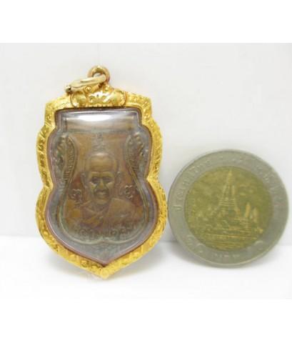 เหรียญเสมา 6 รอบ หลวงพ่อจง เนื้อทองแดง ปี 2487 เลี่ยมทอง ยกซุ้ม นน. 13.14 g