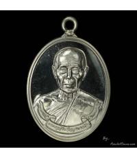 เหรียญห่วงเชื่อมรุ่นแรก หลวงปู่บัว  รุ่น สร้างบารมี ออกวัดศรีบูรพา ปี ๕๔ เนื้อเงิน หมายเลข ๓๑๒