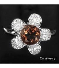 แหวนพลอยแท้  แหวนเงินแท้ 925 พลอยโทปาสสีแชมเปญ (Topaz) ตกแต่งด้วยเพชร CZ คุณภาพสูง