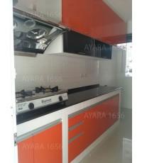 ชุุดครัว Built-in ตู้ล่าง โครงซีเมนต์บอร์ด หน้าบาน Laminate สีส้มเงา - ม.Bangkok Boulevard