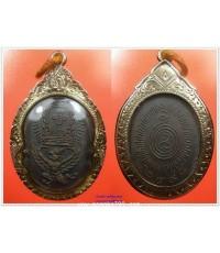 พระเครื่อง เหรียญหลวงพ่อโอภาสี ปี 2498 พิมพ์ทรงครุฑ เนื้อทองแดงรมดำ เลี่ยมทอง