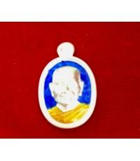 เหรียญเม็ดแตงเนื้อเงินลงยาสีน้ำเงิน หลวงพ่อจรัญ ฐิตธัมโม วัดอัมพวัน รุ่นโภคทรัพย์