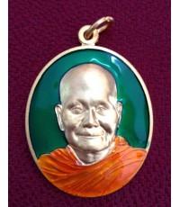 เหรียญทองแดงลงยาสีเขียว หลวงพ่อจรัญ ฐิตธัมโม วัดอัมพวัน รุ่นฉลองอายุวัฒนะมงคล ๘๔ปี