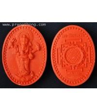 เหรียญพระพิฆเนศวร เนื้อผง รูปไข่ ขนาด 5 ซ.ม. สีส้ม