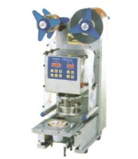 เครื่องแพ็คแนวตั้ง Table automatic cover sealer FRG-2001C.