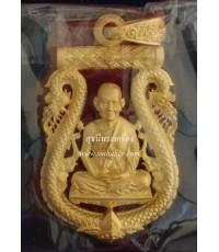 เหรียญเสมาฉลุลายยกซุ้มพญานาคเนื้อบรอนซ์ชุบทองไมครอนลงยาราชาวดีสีแดง