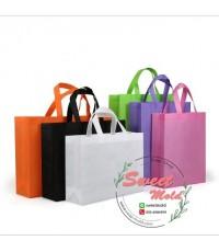 กระเป๋าผ้าสปันบอนด์สีชมพู(แนวนอน)ขนาด30x38x10cmแพ็ค20ชิ้น