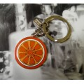 COACH ENAMEL ORANGE SLICE KEYCHAIN 92790